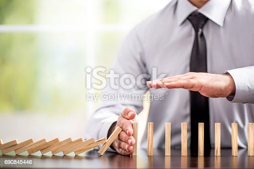Protecting Assets From Domino Effect. Stop Loss Concept For Stock Exchange Market.