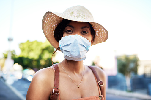 istock Protecting myself from all the polluted air in the city 1178910189