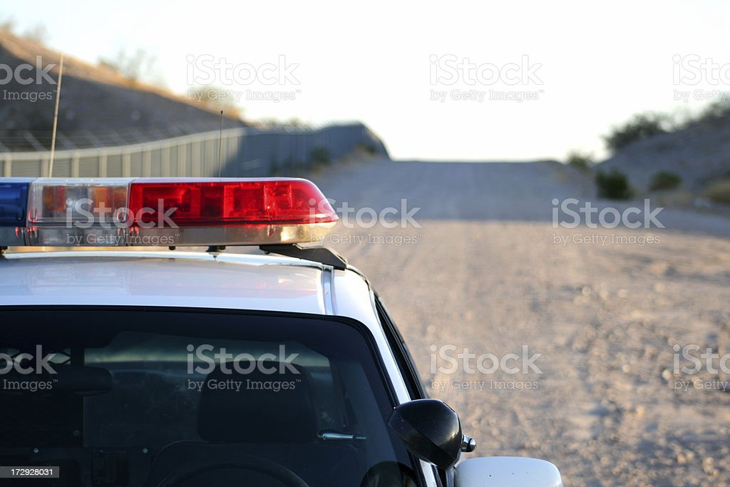 Protecting the fence line royalty-free stock photo
