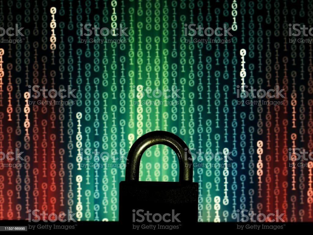 closed padlock in front of matrix style computer language binary data...