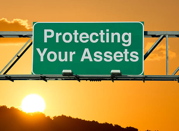 protecting your assets - asset protection stock pictures, royalty-free photos & images