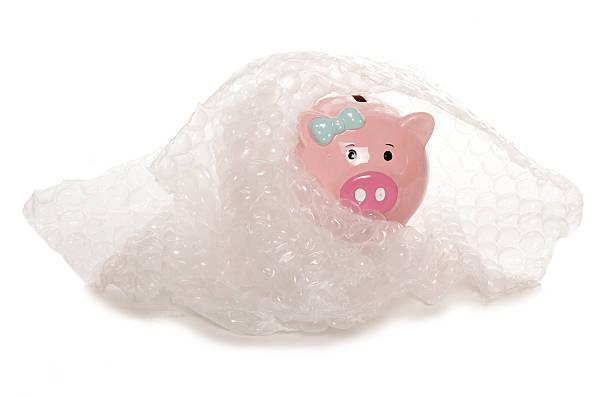 protecting your money piggy bank stock photo