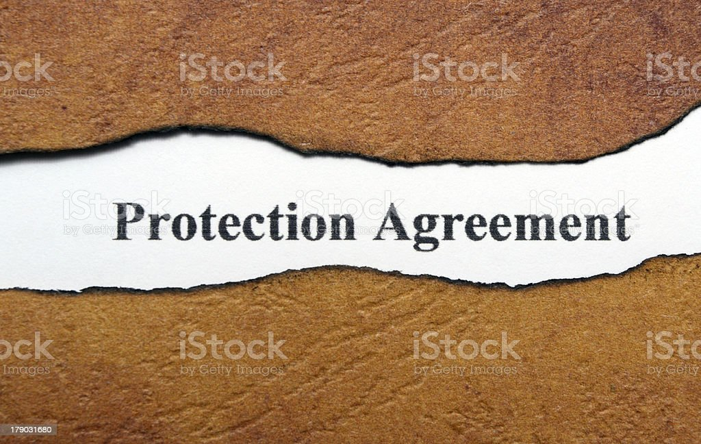 Protection agreement text on torn paper royalty-free stock photo