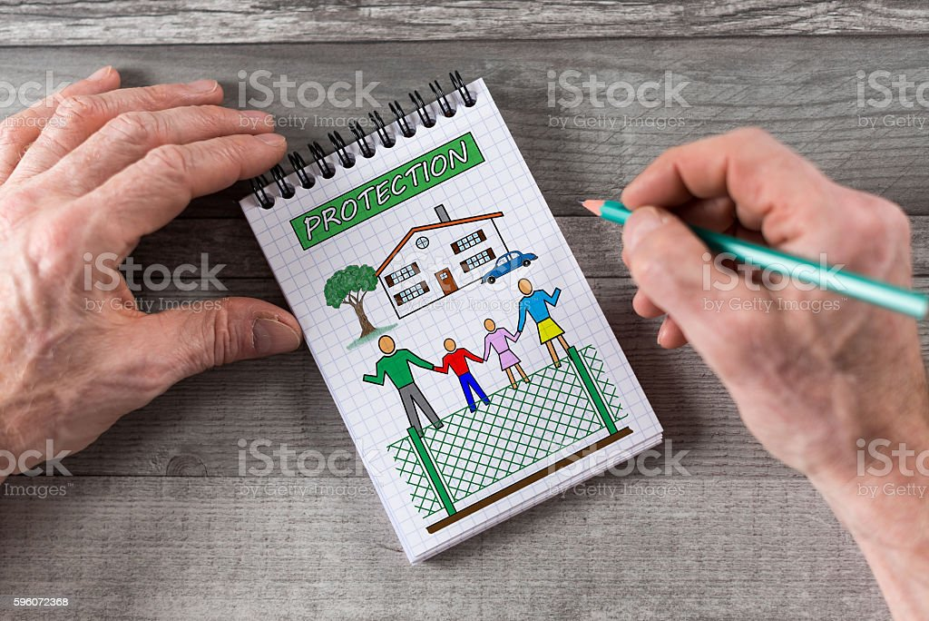 Protection concept on a notepad royalty-free stock photo