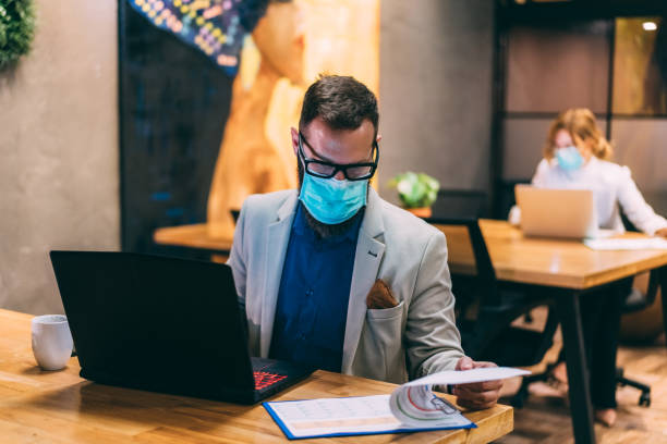 Protection in the office during COVID-19 pandemic stock photo