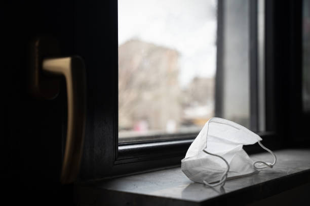 protection medical face mask by the window stock photo