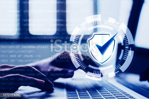 istock Protection network security computer and safe your data concept. Digital crime by an anonymous hacker 1272724092