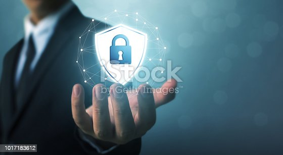 683716072istockphoto Protection network security computer and safe your data concept, Businessman holding shield protect icon 1017183612
