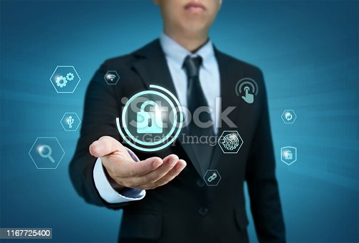istock Protection network security computer and safe your data concept, Businessman holding shield protect icon 1167725400