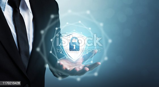 938535190istockphoto Protection network security computer and safe your data concept, Businessman holding shield protect icon 1170215428