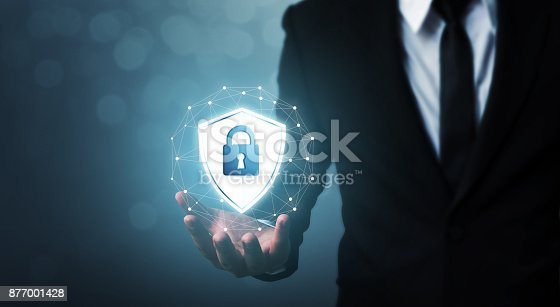istock Protection network security computer and safe your data concept, Businessman holding shield protect icon 877001428