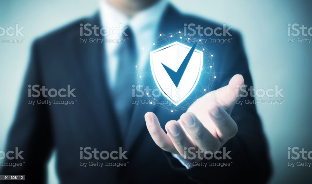 Protection network security computer and safe your data concept, Businessman holding shield protect icon stock photo