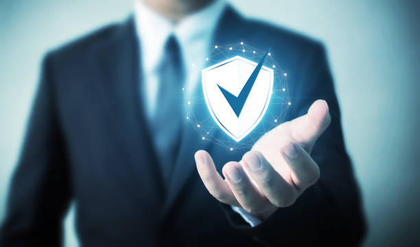 protection network security computer and safe your data concept, businessman holding shield protect icon - fare la guardia foto e immagini stock