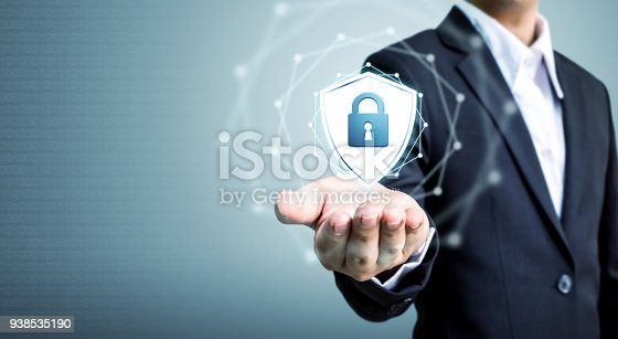 938535190istockphoto Protection network security computer and safe your data concept, Businessman holding shield protect icon 938535190