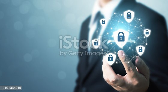 istock Protection network security mobile smart phone and safe your data concept. Digital crime by an anonymous hacker 1191364919