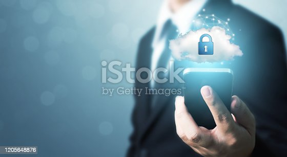 istock Protection network security mobile smart phone and safe your data concept. Digital crime by an anonymous hacker 1205648876