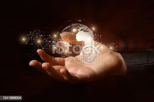 istock Protection of the global network in the hand . 1041898004