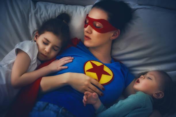 protection of the mother superhero - baby super hero imagens e fotografias de stock