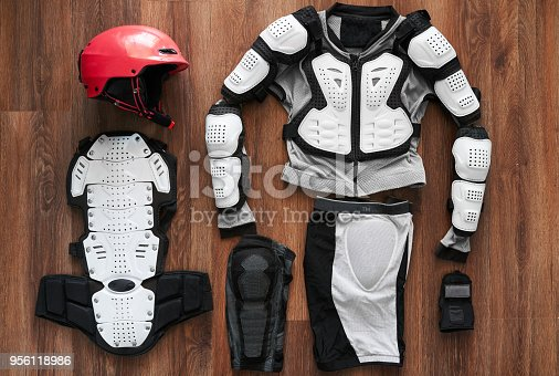 istock protective clothing and a helmet  on wooden floor 956118986