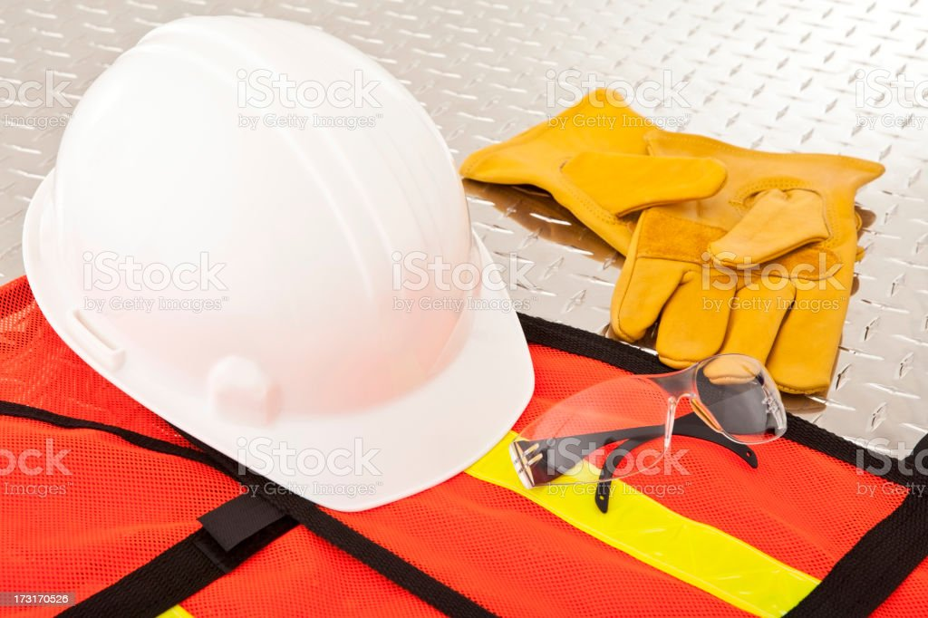 Protective construction workwear laid on metal surface stock photo