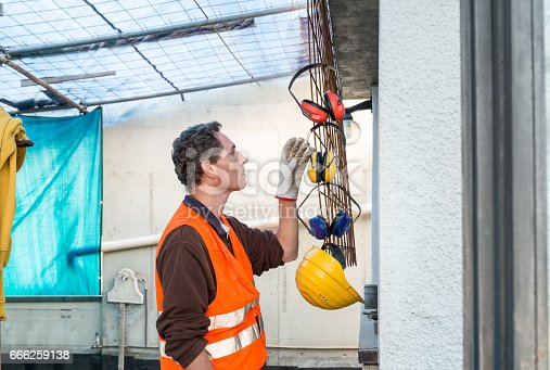 istock Protective ear muffs. Concept of prevention and safety at work 666259138