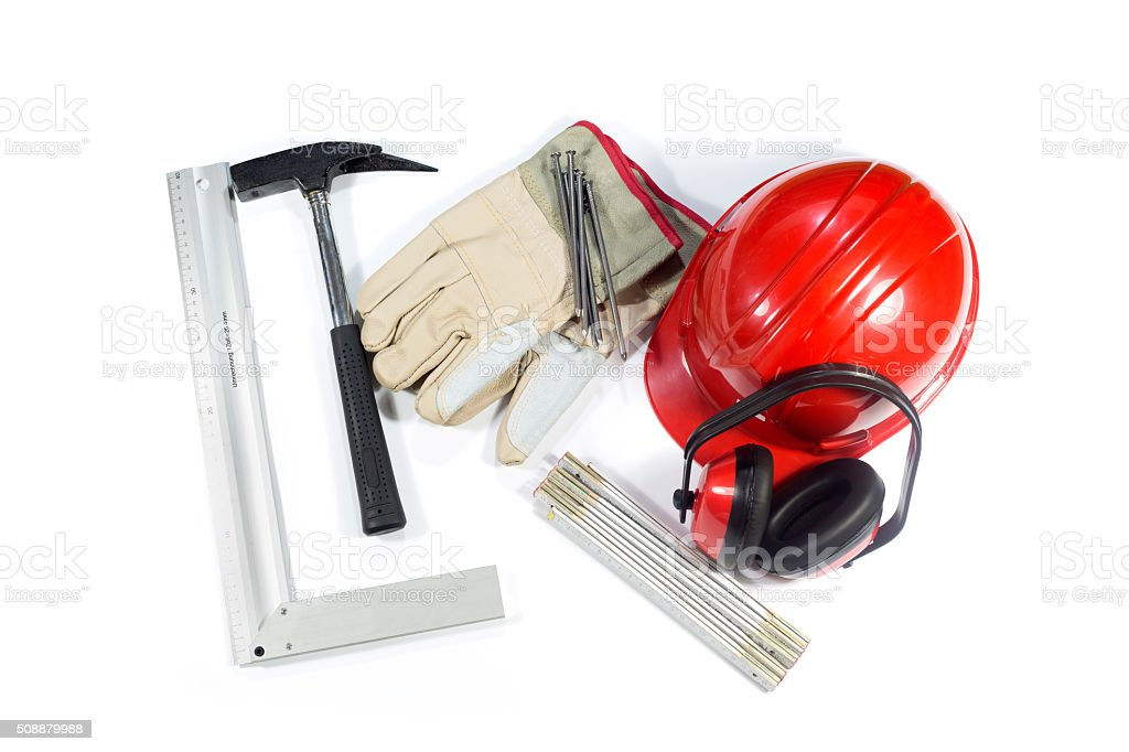 Protective Earmuffs, Hammer, Nails, Gloves, Helmet And Folding Ruler Isolated stock photo