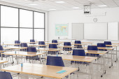 istock Protective Face Masks And Hand Sanitizers On The Desks According To New Normal Concept In An Empty Classroom. 1290836478