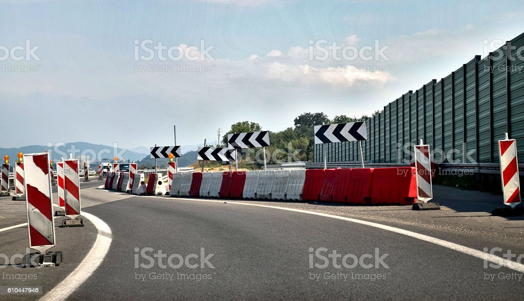 Protective fence and one lane of the highway closed stock photo