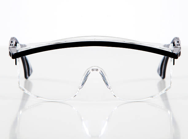 Protective glasses A pair of transparent safety glasses on a white background. protective eyewear stock pictures, royalty-free photos & images