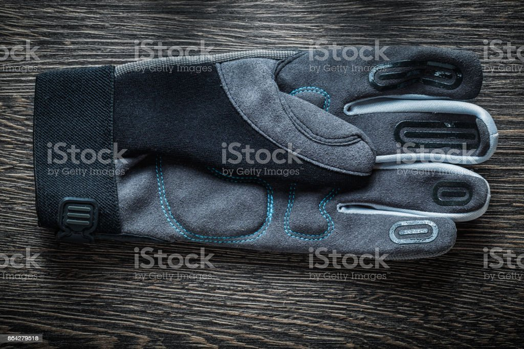 Protective gloves on vintage wooden board royalty-free stock photo