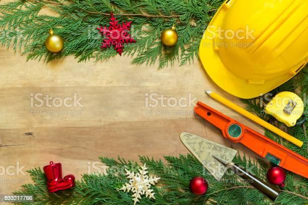 Protective helmet mason tools and christmas decorations on wooden picture id833217766?b=1&k=6&m=833217766&s=612x612&h=uspnct70aksbzgkp2sp0ktz90gycshgwbq16xr8yukk=