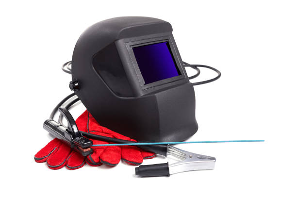 Protective masks and welder's gloves stock photo