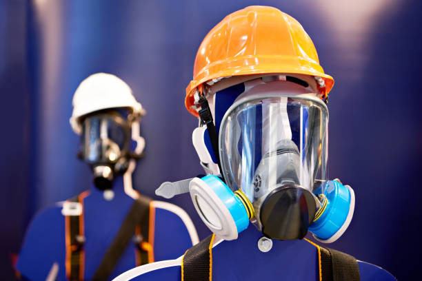 Protective masks with filters for production and construction stock photo