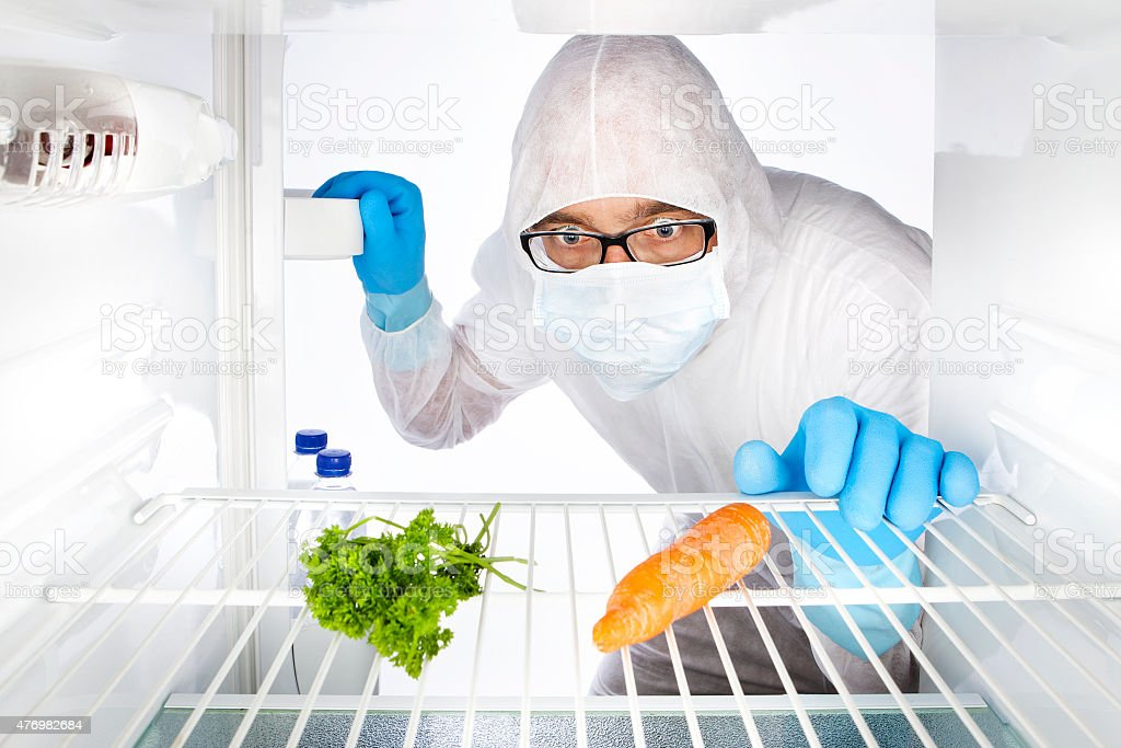 Protective suit and mask fridge carrot food toxic stock photo