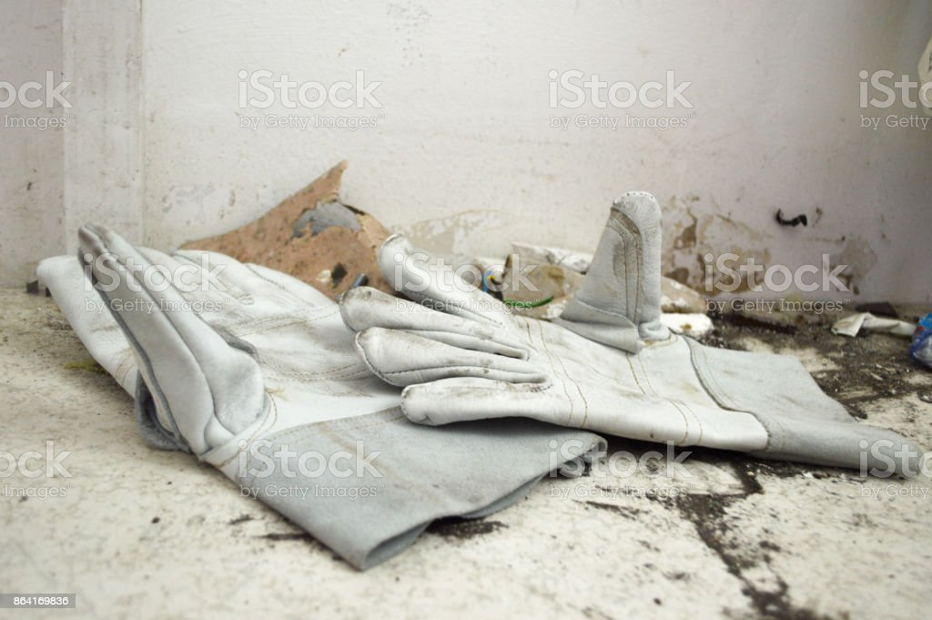 Protective worker leather gloves in dirt royalty-free stock photo