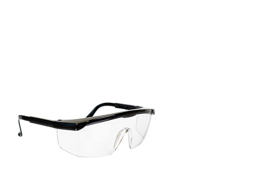 Protective workwear to protect human eyes, safety glasses. Isolated on white background. Copy space