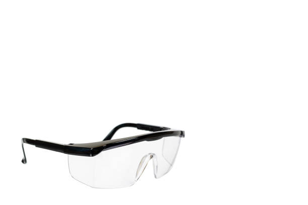 Protective workwear to protect human eyes, safety glasses Protective workwear to protect human eyes, safety glasses. Isolated on white background. Copy space protective eyewear stock pictures, royalty-free photos & images