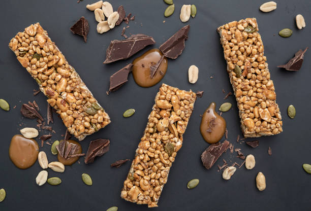 protein bar peanut caramel & dark chocolate - anthony mcgovern stock photos and pictures