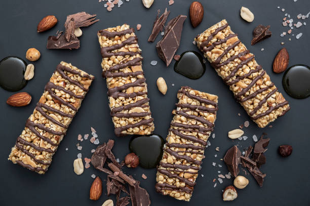 protein bar roasted nut with dark chocolate drizzle - anthony mcgovern stock photos and pictures