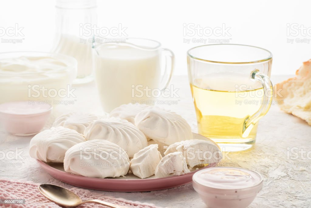Protein products ingredients for breakfast marshmallows sour cream yogurt milk piece of bread green tea royalty-free stock photo