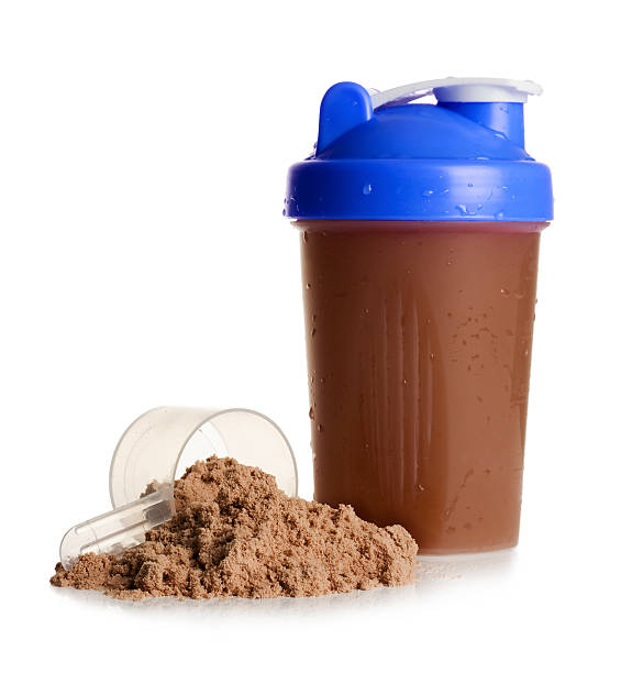 protein shake with protein powder on a white background - protein stock photos and pictures