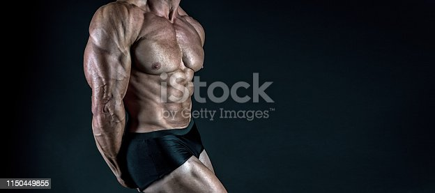 istock Protein supplements. Muscles for actions. Torso six packs attractive black background. Muscular torso huge muscles result of exhausting trainings and proper nutrition. Muscular torso close up 1150449855