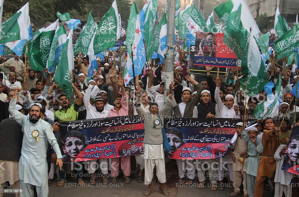 Protest against massacre of Muslims in Burma and Syria stock photo