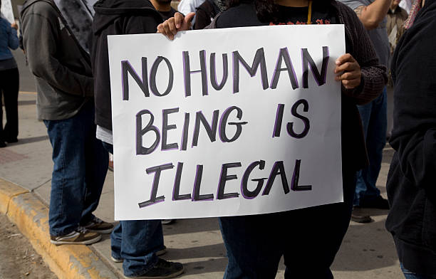 protest sign - emigration and immigration stock photos and pictures
