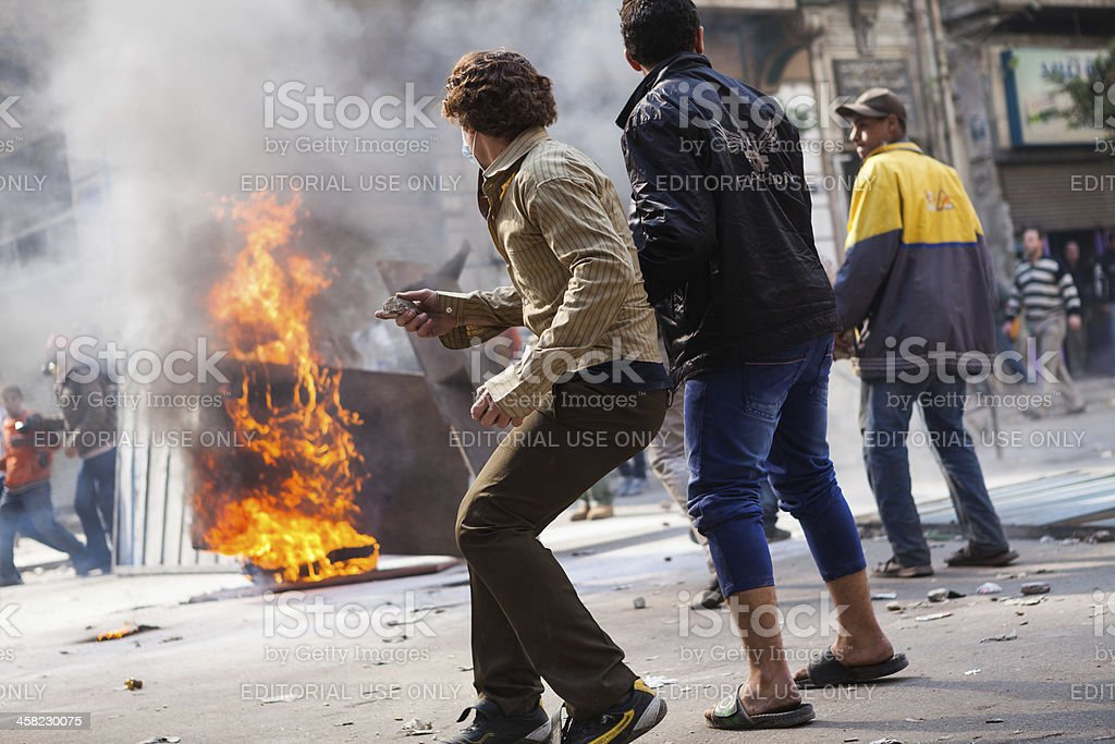 Protester in Egypt ready to throw a stone stock photo