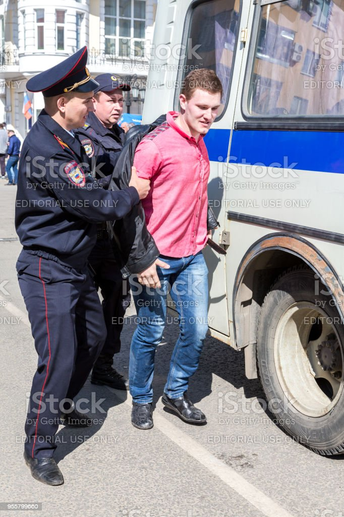 Protester is arrested by police at the opposition rally stock photo