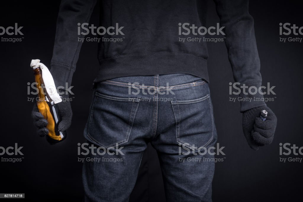 Protester or terrorist with Molotov cocktail (Petrol bomb) and lighter stock photo