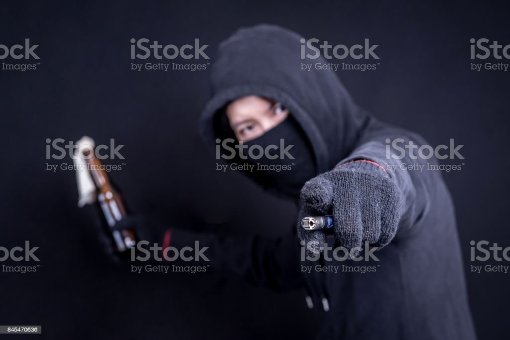 Protester or terrorist with Molotov cocktail as known as petrol bomb or bottle bomb stock photo