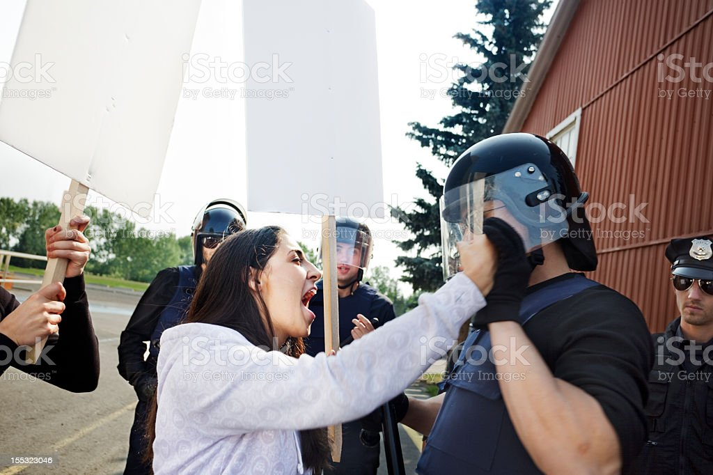 Protester & police get physical stock photo