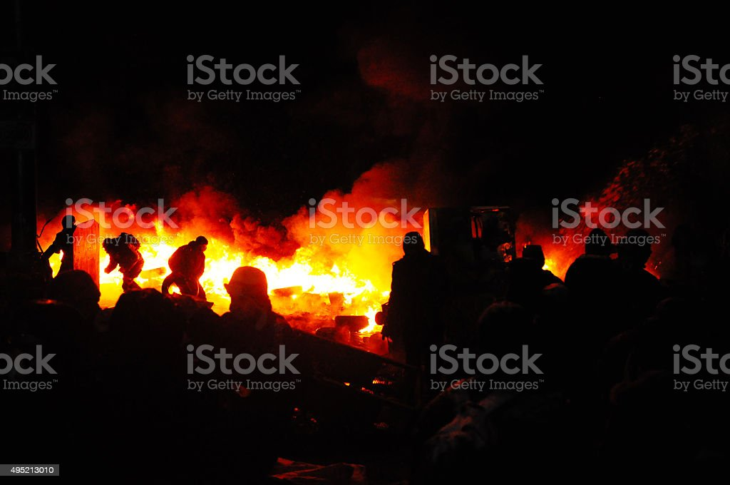 Protester refugee burn tires to stop the riot police. Ukraine. stock photo